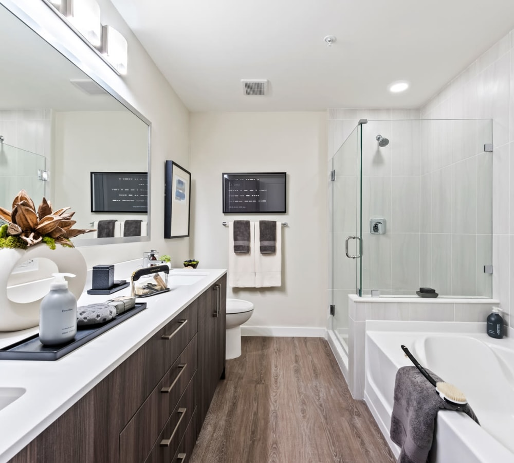 Nice clean bathroom with lots of counter space and big mirror in model home at 6600 Main in Miami Lakes, Florida