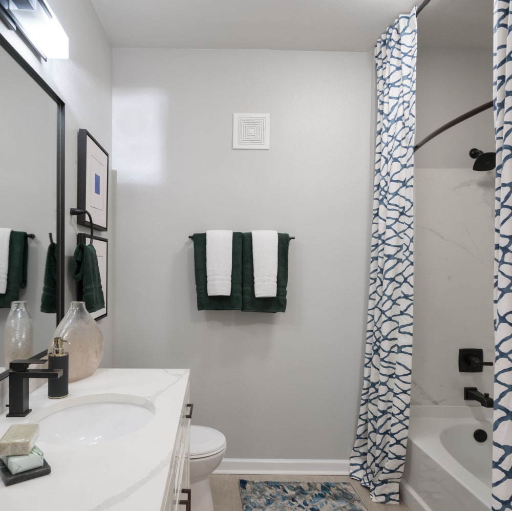 Bathroom with white counter tops at The JaXon in Kingwood, Texas
