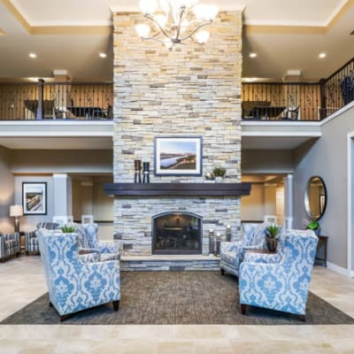 Elegant reception area with stone fireplace at The Sanctuary at West St. Paul in West St. Paul, Minnesota
