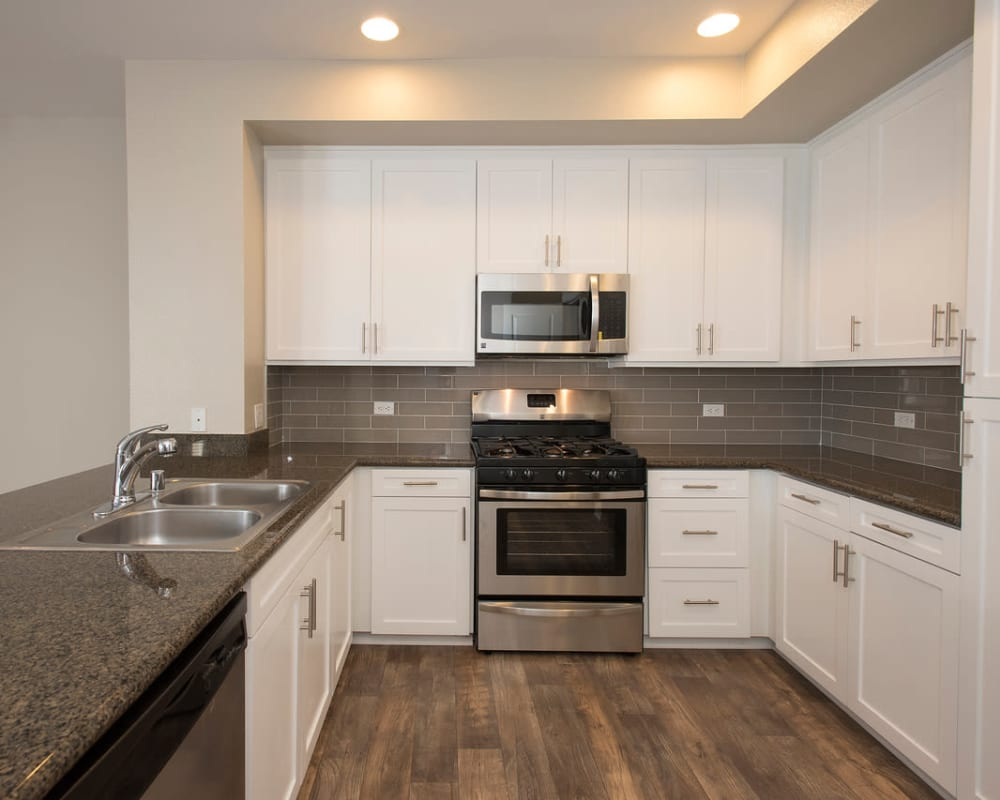 Modern kitchen with stainless-steel appliances in a luxury model home at Paragon at Old Town in Monrovia, California