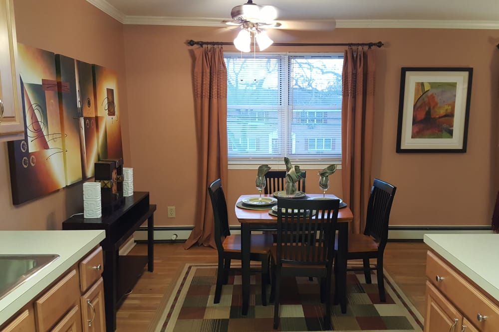 Modern kitchen looking into dining area in model home at Wingate Apartments