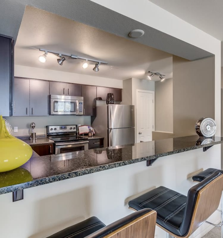 Spacious kitchen with a breakfast bar in a model home at Vue Issaquah in Issaquah, Washington