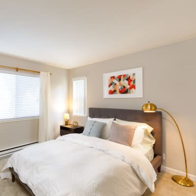 Beautifully decorated bedroom in a model home at Sofi Waterford Park in San Jose, California