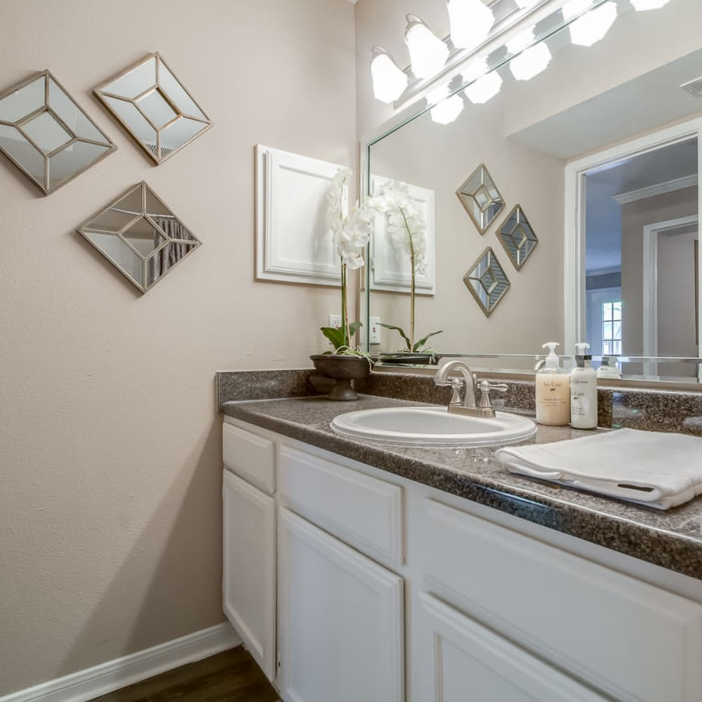 Contemporary bathroom with granite counters at Hayden at Enclave in Houston, Texas