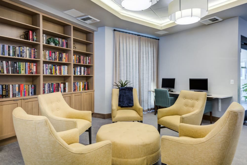 resident library with seating area