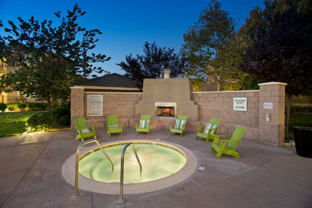 Hot tub next to a fireplace at Cross Pointe Apartment Homes in Antioch, California