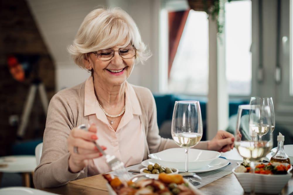 A woman dining at Broadwell Senior Living in Kearney, Nebraska