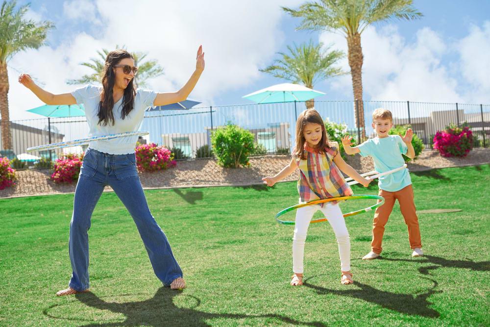 Family playing outdoors at BB Living at Eastmark in Mesa, Arizona