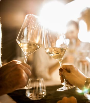 Residents enjoying a glass of wine on date night near Cortland Village Apartment Homes in Hillsboro, Oregon