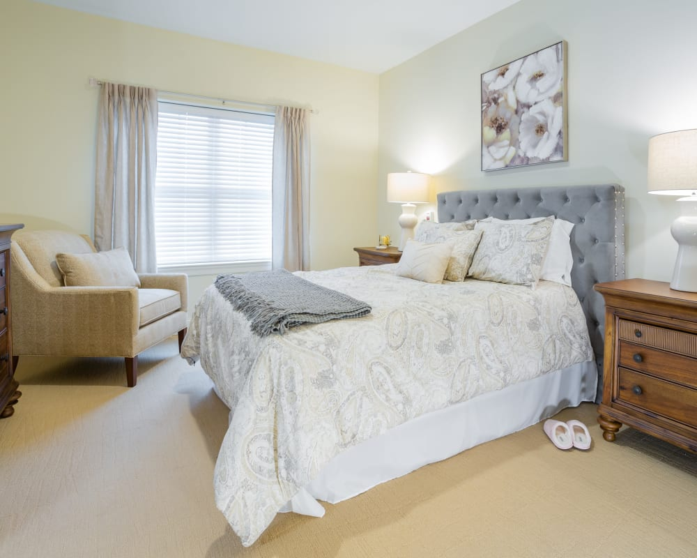 A decorated bedroom at Harmony at Elkhart in Elkhart, Indiana