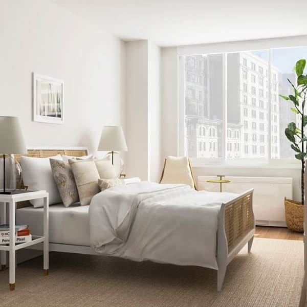 Incredibly spacious bedroom with a nice area rug at the end of the bed at The Melar in New York, New York