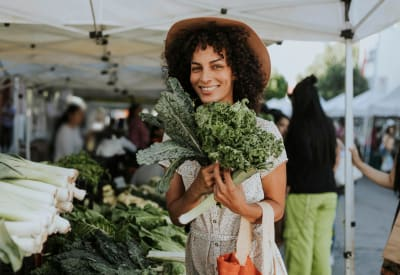 Resident shopping for produce at a local farmers market near Worthington Meadows in Columbus, Ohio