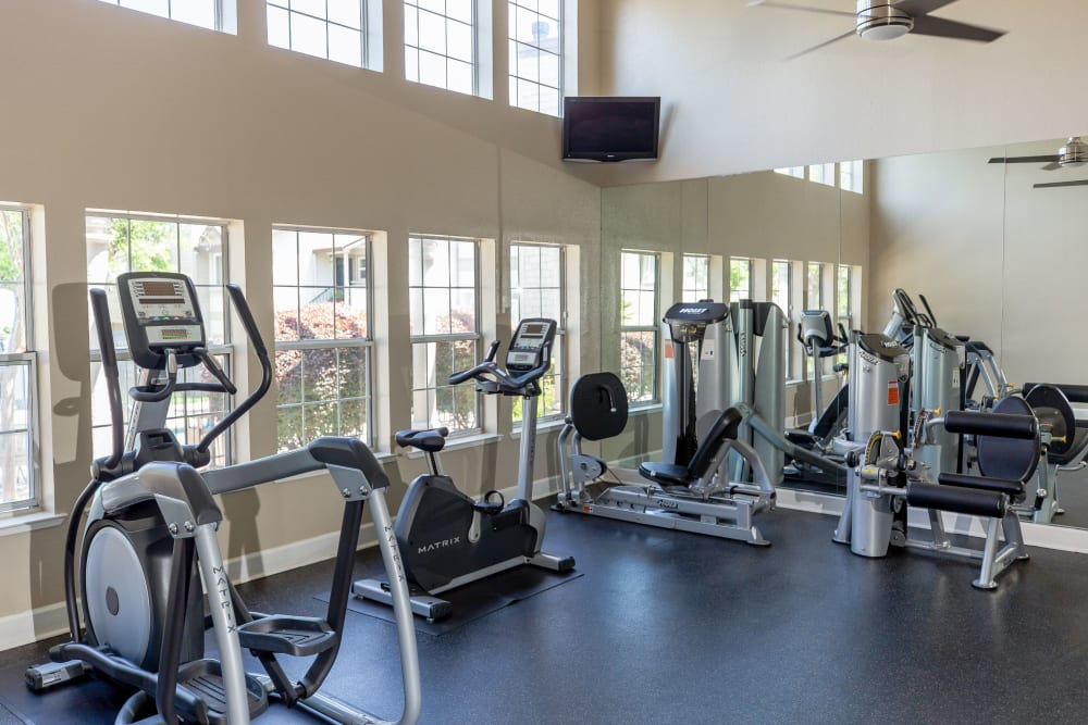 Spacious fitness center with a ceiling fan  at Shaliko in Rocklin, California