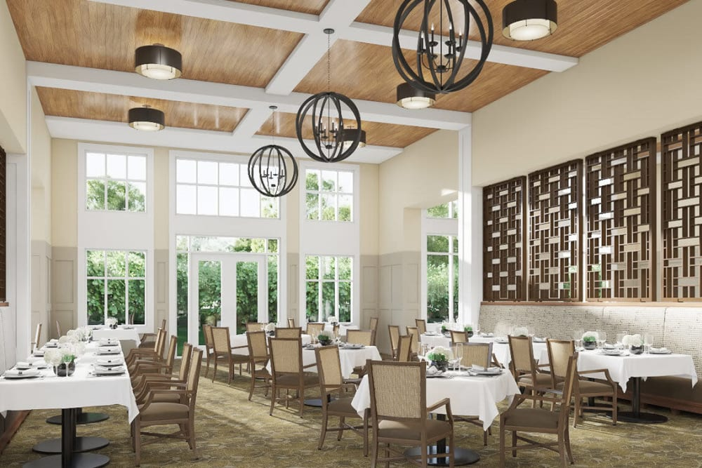 Bright and airy common dining room with modern chandeliers in upscale senior living facility at The Springs at Sherwood in Sherwood, Oregon