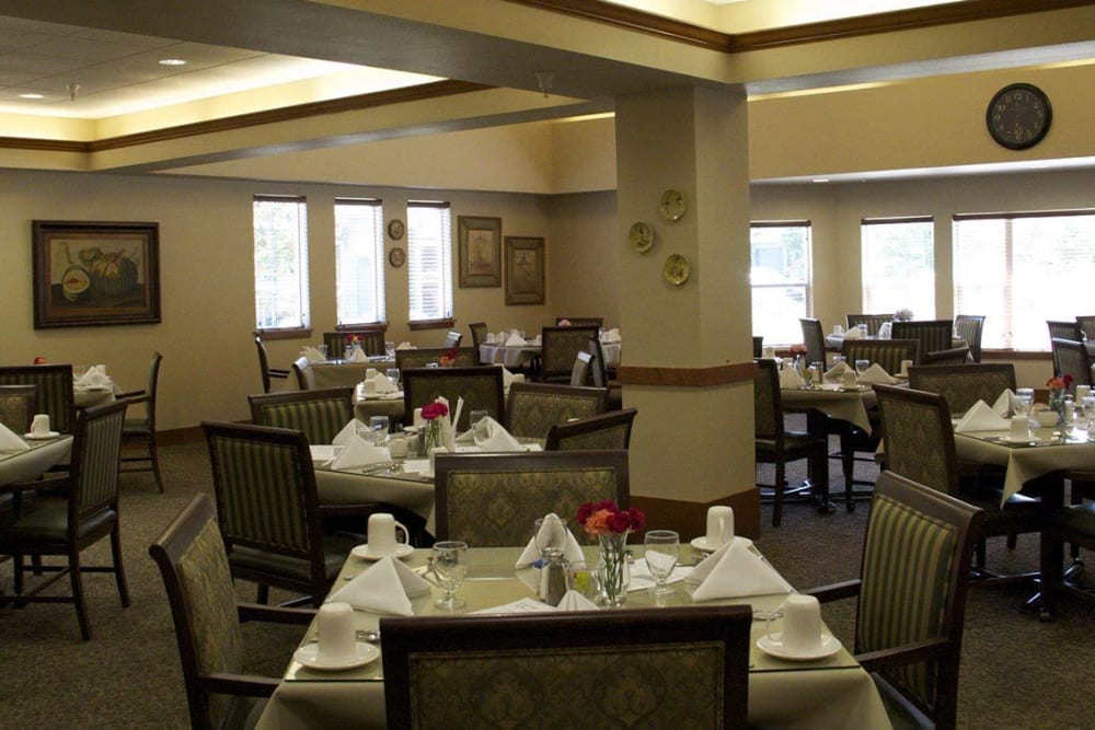 Communal dinning hall of upscale senior living facility complete with elegant dark accents at The Springs at Mill Creek in The Dalles, Oregon