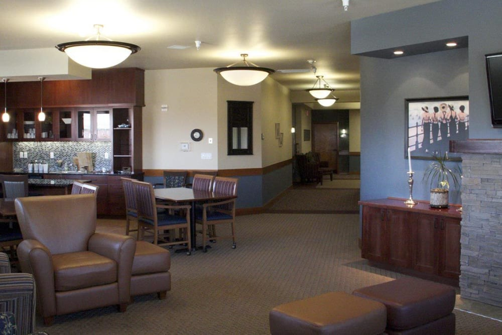 Front lobby at upscale senior living facility complete with leather arm chairs, television set, and fireplace at The Springs at Mill Creek in The Dalles, Oregon
