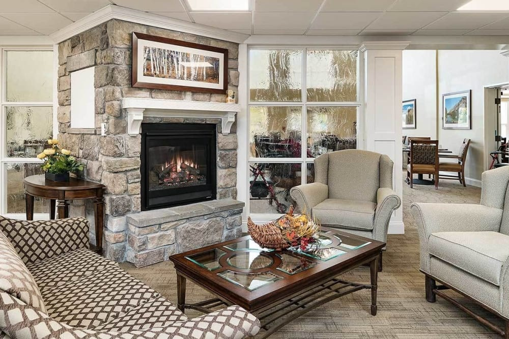 Lobby seating in upscale senior living facility with iniviting fireplace at The Springs at Grand Park in Billings, Montana
