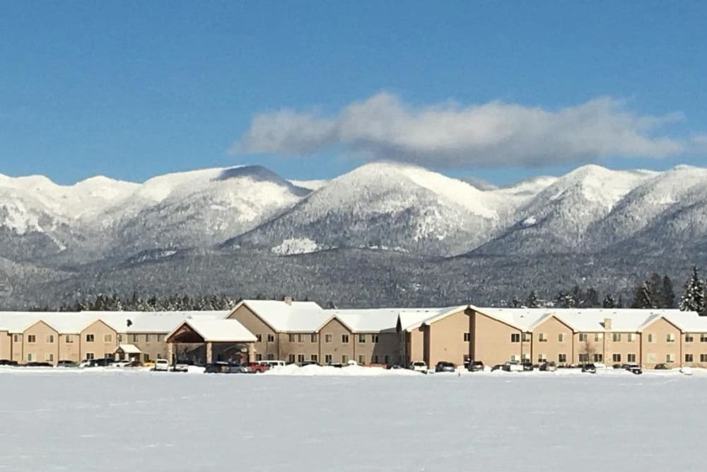 Outside view of  The Springs at Whitefish with mountains in the background in Whitefish, Montana