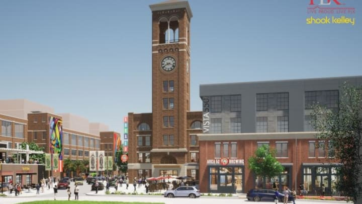 Photo of planned site showing large clocktower