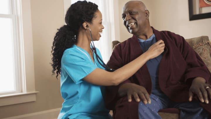 Nurse listening to senior man