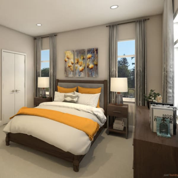 Furnished bedroom with a large bed inside a cottage at Quail Park at Browns Point in Tacoma, Washington
