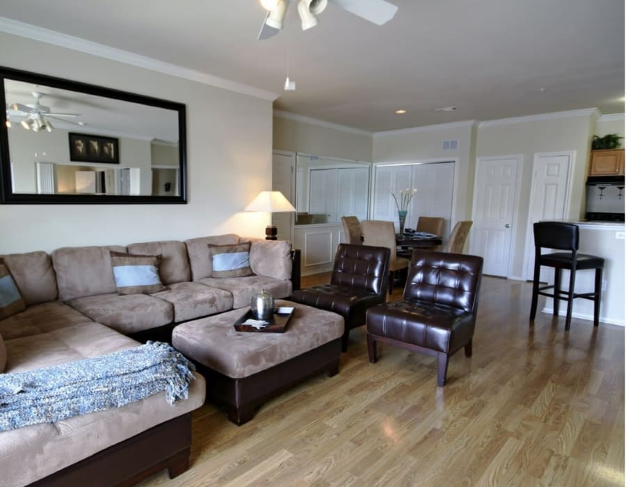 Well-decorated living area in a model home at Vail Quarters in Dallas, Texas