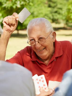 Resident playing a card game at Lassen House Senior Living in Red Bluff, California