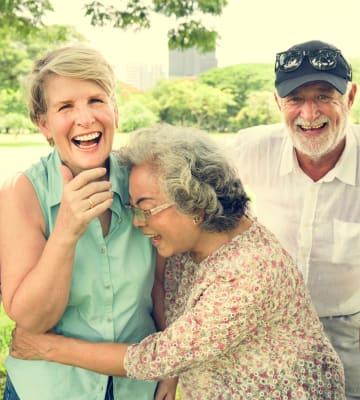 Happy residents hugging at Honeysuckle Senior Living in Hayden, Idaho