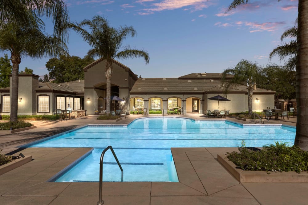 Sundeck with a umbrellas for shade at River Oaks Apartment Homes in Vacaville, California