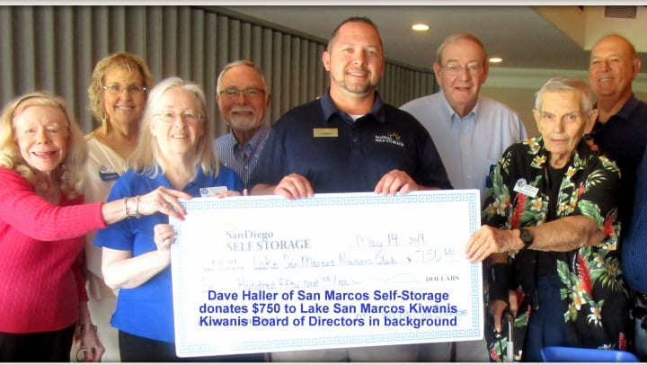 San Marcos Mini Storage presenting a check to Lake San Marcos Kiwanis Club Foundation