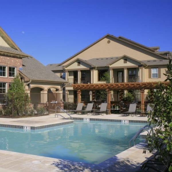 Resort-style swimming pool at Wood Crest Apartment Homes in Chalmette, Louisiana