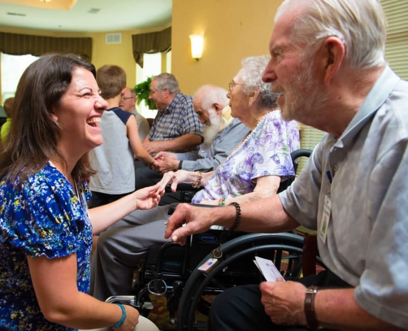 A staff member laughing with a resident at Ebenezer Ridges Campus in Burnsville, Minnesota.