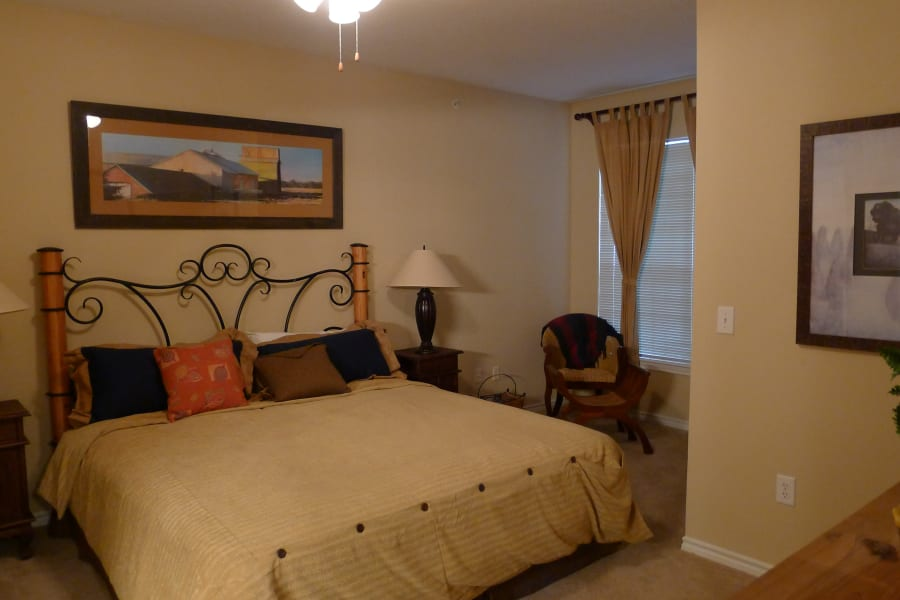 Model apartment bedroom at Lodge at West Oaks