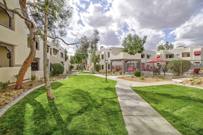 Courtyard walking path at Casa Santa Fe Apartments in Scottsdale, Arizona