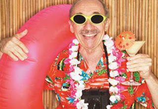 Senior living resident dressed for a beach party in Greer