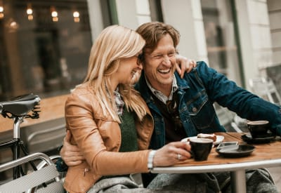 Resident couple enjoying coffee while they take a break from shopping downtown near Rockbrook Creek in Lewisville, Texas