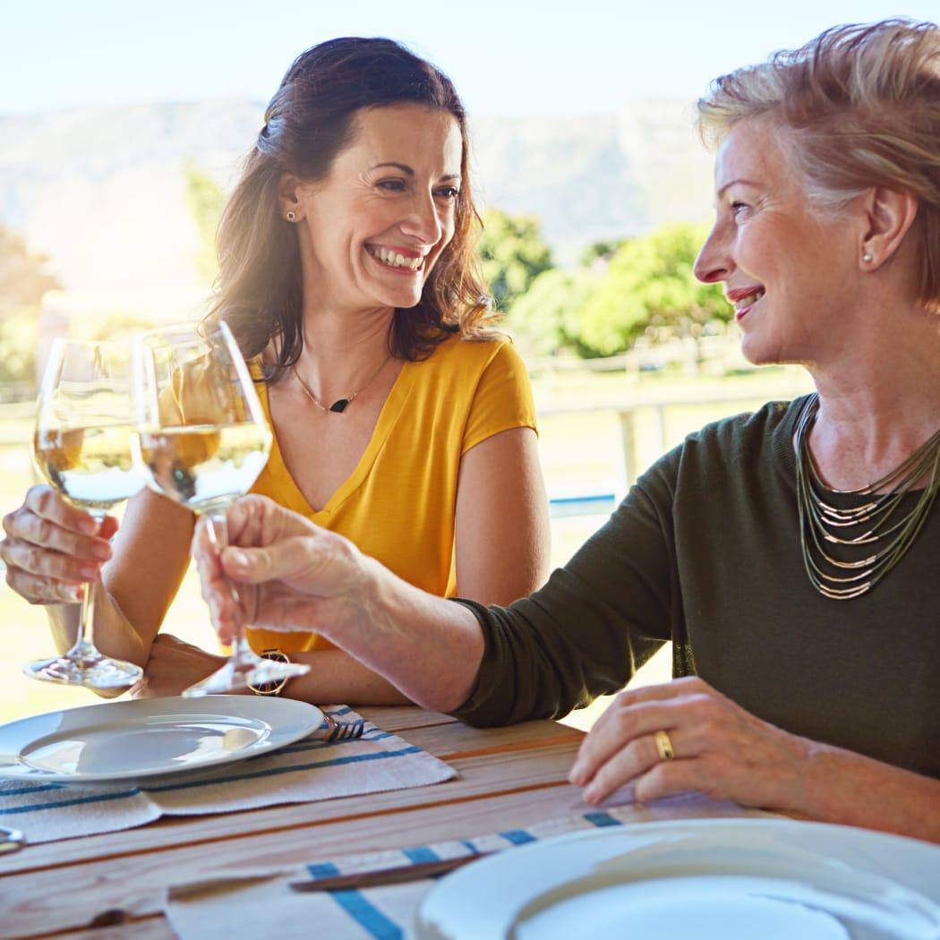 Two friend enjoying wine near Avilla Paseo in Phoenix, Arizona