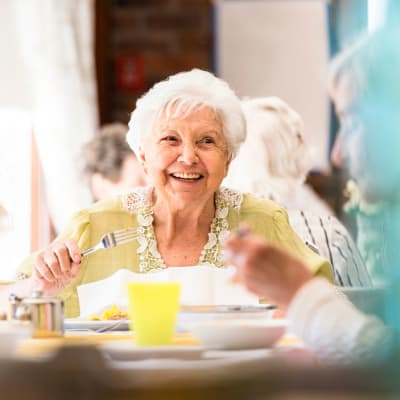 A resident enjoys dining at First & Main of Bloomfield Township in Bloomfield Township, Michigan