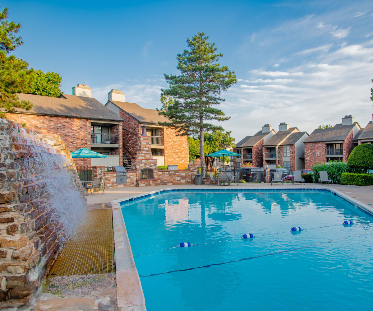 Swimming pool & waterfall at Warrington Apartments' fitness center in Oklahoma City, Oklahoma