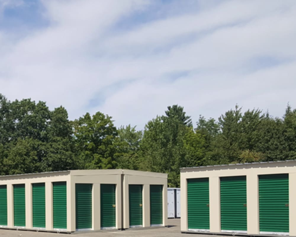 A row of outdoor units with green doors at 603 Storage - Route 27 in Raymond, New Hampshire