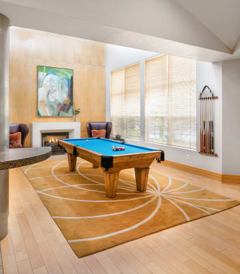 Contemporary clubhouse with a billiards table and large windows at Center Pointe Apartment Homes in Beaverton, Oregon