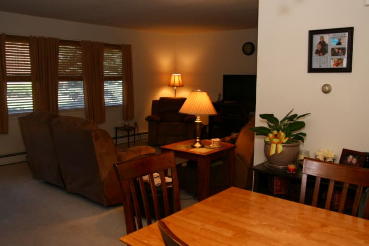 Model home dining area and living room at Waterway Court Apartments