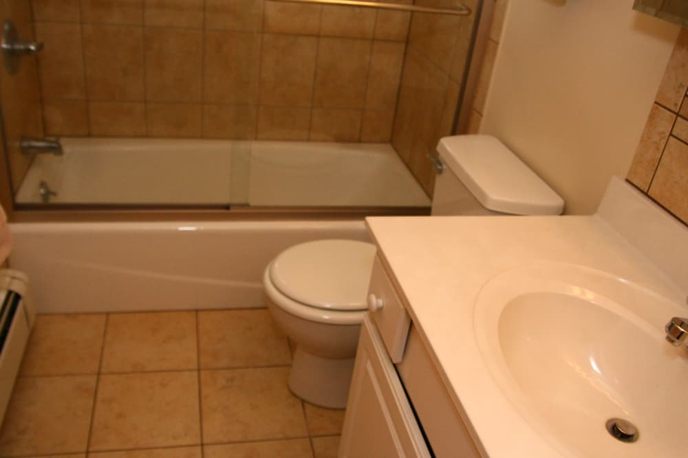 A full bathroom with a white sink at Riverwood Commons