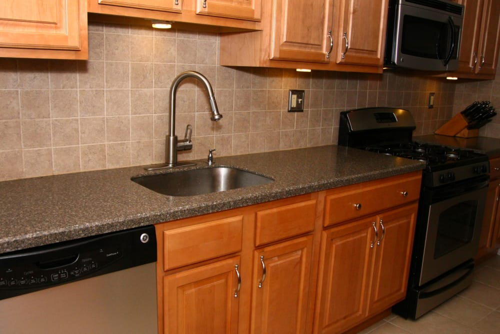 An updated kitchen model at Chilton Towers with stainless steel sink faucets