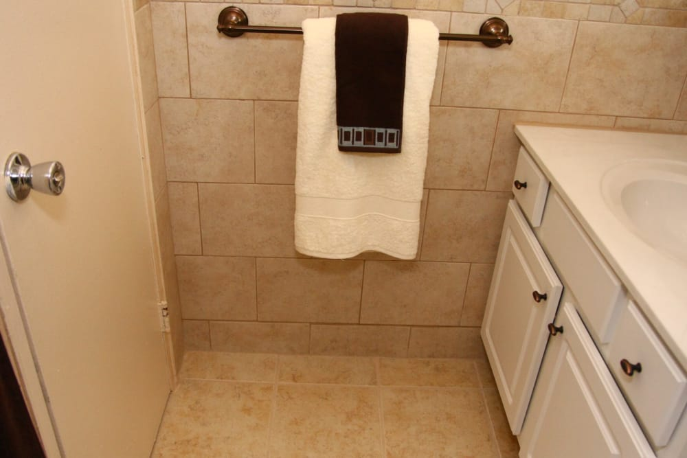 A towel rack with hanging towns at Chilton Towers
