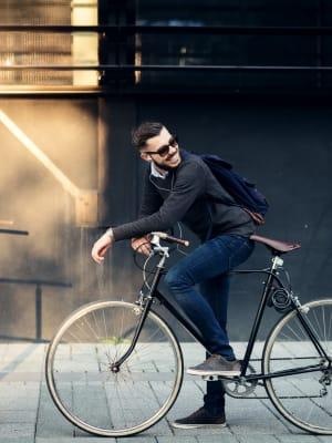 A guy bikes to work in Denver, Colorado