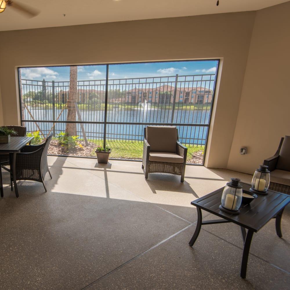 Comfortable seating next to a large window at Inspired Living Bonita Springs in Bonita Springs, Florida.