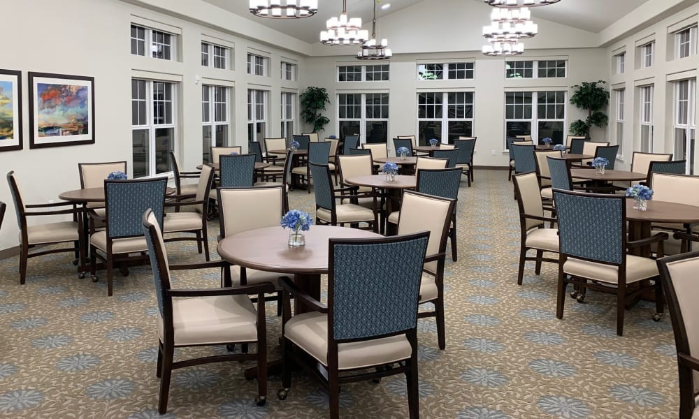 The large community dining room at Camellia Gardens Gracious Retirement Living in Maynard, Massachusetts