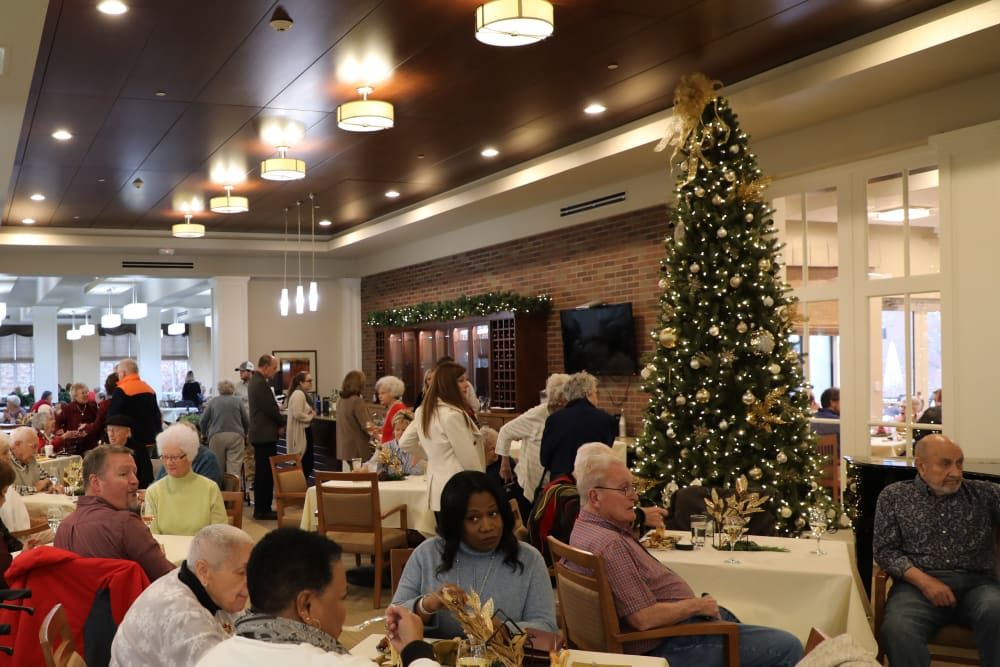 Residents and family members gathered in the dining room at our senior living community