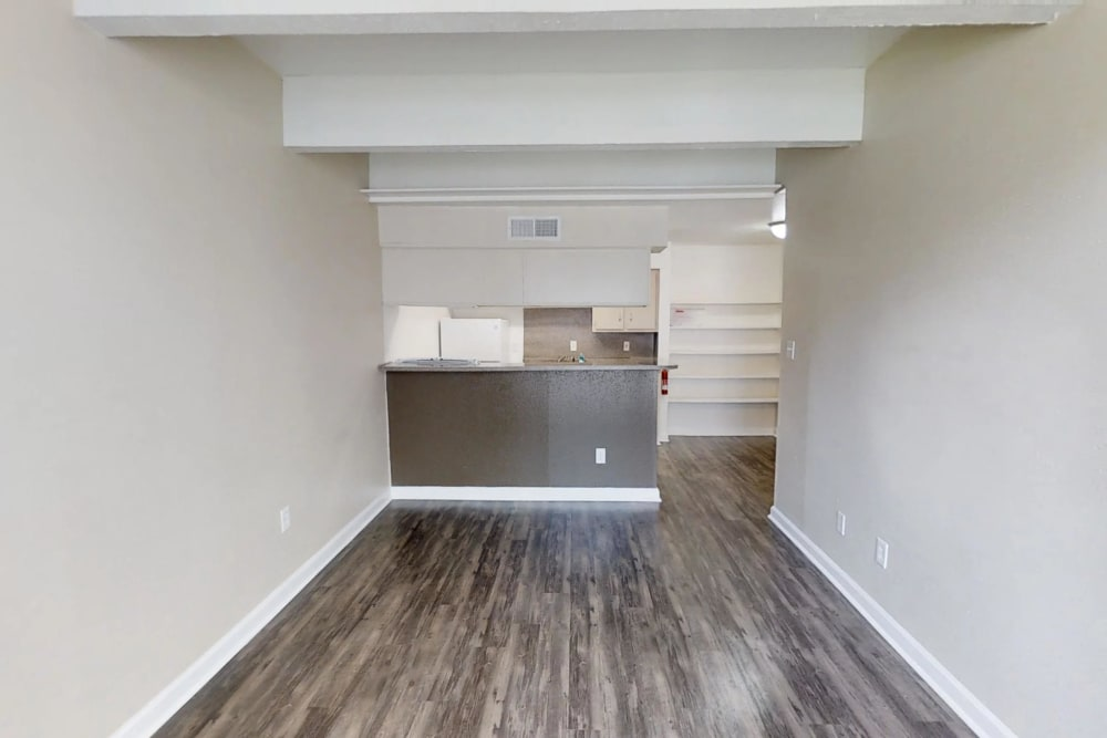 Wood-style flooring at Falls of Maplewood Apartments in Houston, Texas